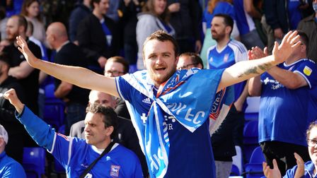 A Town fan pictured after the final whistle.